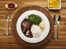 Brazilian feijoada. Dish on rustic table stock images