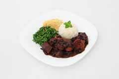 Brazilian Feijoada in a package. Brazilian Feijoada dish on a white background royalty free stock photography