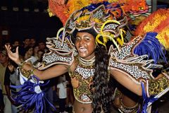Brazilian female dancer during street carnival in Rio. Brazil: Delighted young woman singing and during the Carnival parade in the city Rio de Janeiro. Her face Stock Images