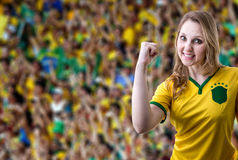 Brazilian female fan celebrating in the stadium Royalty Free Stock Photo