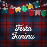 Brazilian Festa Junina greeting card, invitation. Party decoration, string of lights, paper flags. Checkered tartan. Brazilian Festa Junina greeting card Stock Photo