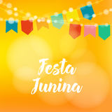 Brazilian Festa Junina greeting card, invitation. Party decoration, string of lights, paper flags. Modern blurred. Brazilian Festa Junina greeting card Royalty Free Stock Photos