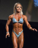 Brazilian Figure Bombshell. Brazilian bombshell Janaina Ferreira poses at the 2015 IFBB Vancouver Pro/Am & Expo Figure competition on July 26, 2015.  The event Royalty Free Stock Image
