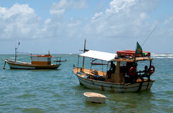 Brazilian Fisherman. Sunshine and fishing boats in Atlantic Ocean in Brazil Royalty Free Stock Images