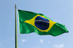 Brazilian Flag. The national flag of Brazil (Brasil) flutters in the wind on a bright, sunny Brazilian day Stock Photography