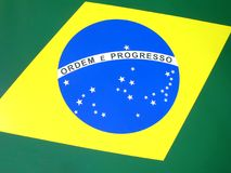 Brazilian flag. Close-up view of the national flag of Brazil. The Brazilian flag is composed of a yellow rhombus on a green rectangle, inside which there is a stock illustration
