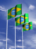 Brazilian flag. The flag of Brazil flies in front of a blue sky vector illustration