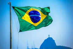 Brazilian flag on the background of Christ the Redeemer Stock Photo