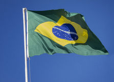 Brazilian Flag on a blue sky. Royalty Free Stock Photo
