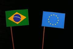 Brazilian flag with European Union EU flag isolated on black. Background Stock Images
