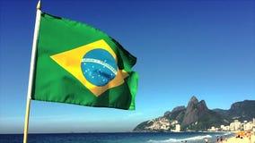 Brazilian Flag Flying Rio de Janeiro Brazil. Brazilian flag flying in slow motion above the city skyline at Ipanema Beach in Rio de Janeiro, Brazil stock footage
