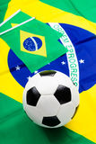 Brazilian flag and football Royalty Free Stock Images
