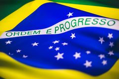 Brazilian flag in a macro view. This picture is a top of view photo from the brazilian flag. It`s a picture with a lot of movement and represents, honor stock images
