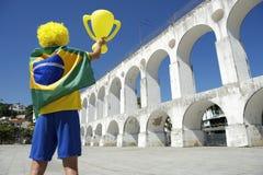 Brazilian Flag Man Arcos da Lapa Arches Rio de Janeiro. Man in Brazil flag holding trophy over Arcos da Lapa Arches Rio de Janeiro Brazil Stock Photography
