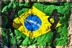 Brazilian Flag Painted on the Rock with Silhouettes of Women Royalty Free Stock Photography