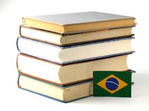 Brazilian flag with pile of books isolated on white background. Brazilian flag with pile of books isolated on white Royalty Free Stock Photo