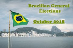Brazilian flag on a pole waving set against Copacabana, Rio de Janeiro, Brazil, with a message of upcoming General Elections in Oc. Brazilian flag on a pole royalty free stock photography