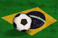 Brazilian flag with soccer ball. Brazilian flag with a soccer ball Royalty Free Stock Image