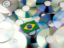 Brazilian flag on top of CD and DVD pile isolated on white. Brazilian flag on top of CD and DVD pile isolated Stock Image