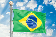 Brazilian flag waving in blue cloudy sky, 3D rendering. Brazilian flag waving in blue cloudy sky, 3D Royalty Free Stock Photo