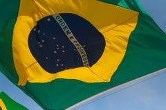 Brazilian flag. Waving brazilian flag with blue sky Stock Photography