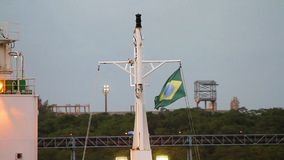 Brazilian flag on a mast. Brazilian flag waving in the wind on a mast of cargo ship stock footage