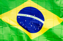 Brazilian flag in the wind in unlight Royalty Free Stock Photos