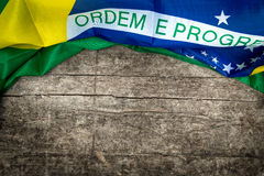 Brazilian flag on wooden background Stock Photo
