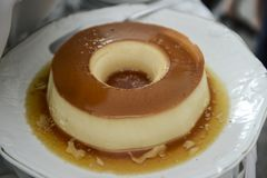 Brazilian flan made with milk and condensed milk, topped with caramel sauce. (Pudim de leite stock photography