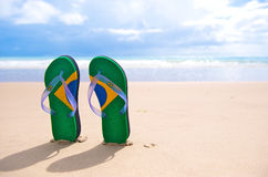 Brazilian Flipflop. With a coconut on the beach in Brazil royalty free stock photo