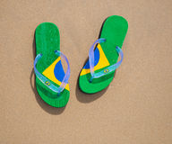 Brazilian Flipflop. With a coconut on the beach in Brazil royalty free stock images