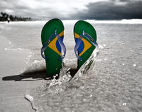 Brazilian Flipflop. With a coconut on the beach in Brazil royalty free stock photography