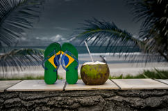 Brazilian Flipflop. With a coconut on the beach in Brazil stock photo