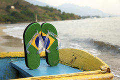 Brazilian Flipflop. Posing on a boat bench, Ilhabela, Sao Paulo state, Brazil royalty free stock photography