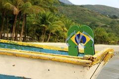 Brazilian Flipflop. Posing on a boat bench, Ilhabela, Sao Paulo state, Brazil stock photo