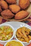 Brazilian food: acaraje with typical fillings. In a table of regional food restaurant royalty free stock photography
