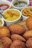 Brazilian food: acaraje with typical fillings. In a table of regional food restaurant royalty free stock photo