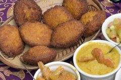 Brazilian food: acaraje with typical fillings. In a table of regional food restaurant royalty free stock image