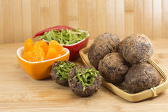 Brazilian food Bolinho de Feijoada. Stuffed with kale on wood background royalty free stock photo