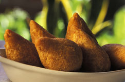 Brazilian food: coxinhas. Brazilian food: Coxinhas (fried chicken cakes), a common appetizer throughout Brazil. Also known as coxinha de galinha or coxinha de Stock Images