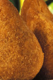 Brazilian food: coxinhas. Brazilian food: Coxinhas (fried chicken cakes), a common appetizer throughout Brazil. Also known as coxinha de galinha or coxinha de Stock Photography