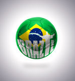 Brazilian Football. Football ball with the national flag of Brazil on a gray background vector illustration