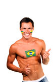 Brazilian football fan. Cheerful happy brazilian football fan with flag on his body and face, isolated on white stock photography