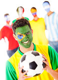 Brazilian football fan with a group Stock Photography