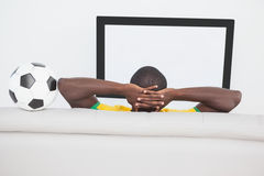 Brazilian football fan watching the tv Stock Image