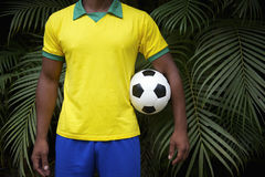 Brazilian Football Player Holding Soccer Ball in Jungle Royalty Free Stock Photos