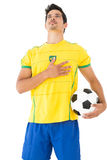 Brazilian football player listening to anthem Stock Photography