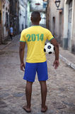 Brazilian Football Player in 2014 Shirt Street in Brazil Royalty Free Stock Image