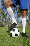 Brazilian Football Player Standing with Soccer Ball Palm Trees Royalty Free Stock Photo