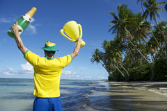 Brazilian Football Player Trophy Champange on Beach Royalty Free Stock Images